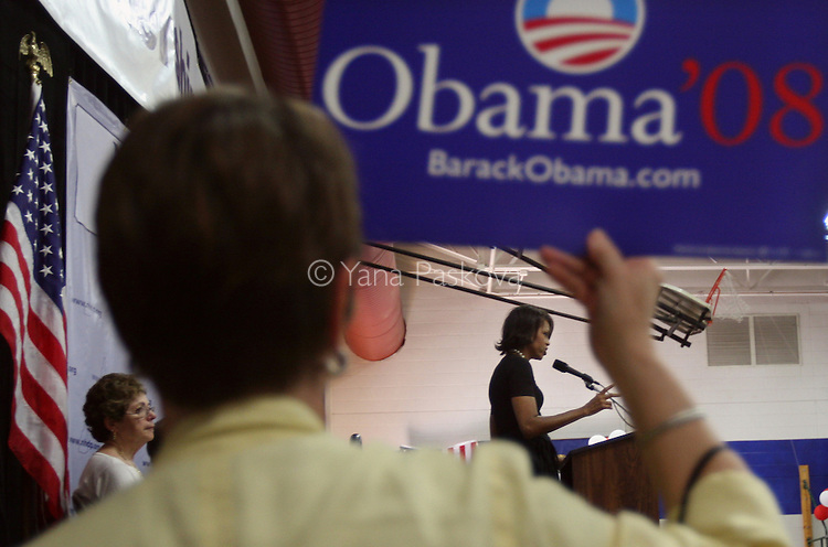 Michelle Obama, wife of Democratic presidential hopeful Senator Barack Obama, spoke to supporters with her daughters Sasha (wearing red) and Malia (wearing white,) and her mother, Marian Robinson, during a Women for Obama rally in Concord, New Hampshire, on June 2, 2007. .