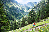 Trail running up a steep mountain trail above the Weisstannental to the Pizol, Switzerland
