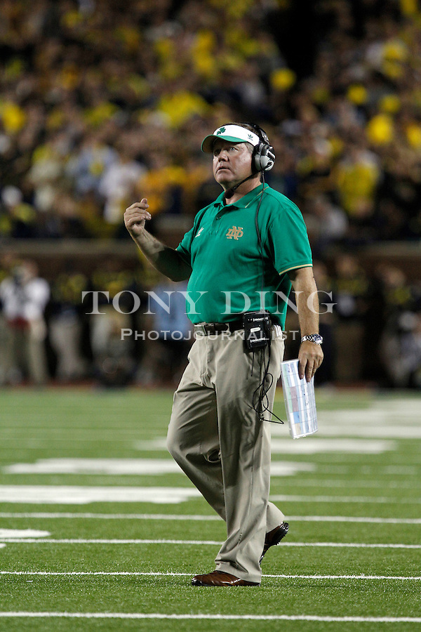 Notre Dame head coach Brian Kelly gestures from the sidelines in the fourth quarter of an NCAA college football game against Michigan, Saturday, Sept. 10, 2011, in Ann Arbor. Michigan won 35-31. (AP Photo/Tony Ding)