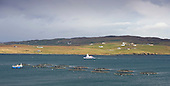 Shetland - the inter-island relief ferry Fivla passes a fish farm in Dury Voe heading for Laxo Pier with Vidlin and Lunnasting in the distance - picture by Donald MacLeod - 02.04.14 – 07702 319 738 – clanmacleod@btinternet.com – www.donald-macleod.com