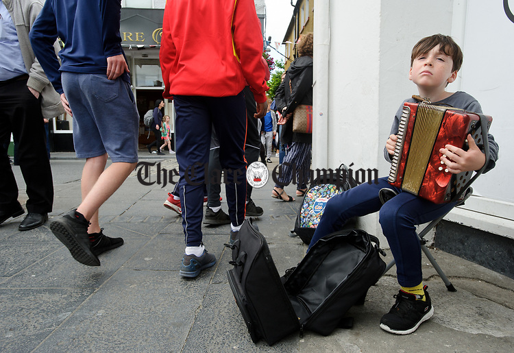 Niall Fitzgerald of Cashel performing in O Connell square during Fleadh Cheoil na hEireann in Ennis. Photograph by John Kelly.