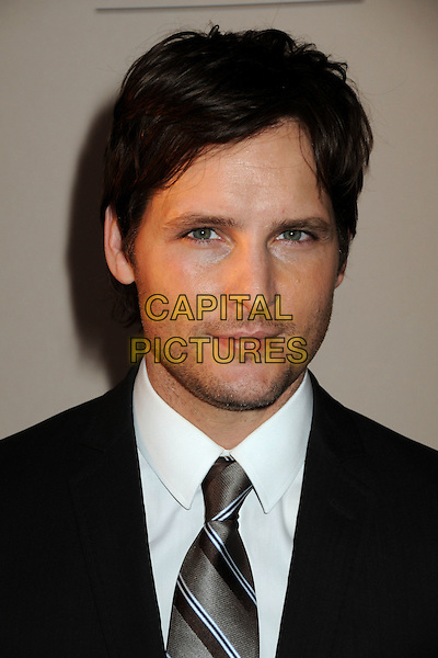 "PETER FACINELLI .Attending An Evening with ""Nurse Jackie"" Presented by the Academy of Television Arts & Sciences held at the Leonard H. Goldenson Theatre, North Hollywood, California, USA, .15th March 2010..portrait headshot  black grey gray  tie brown gold striped white shirt stubble facial hair .CAP/ADM/BP.©Byron Purvis/Admedia/Capital Pictures"