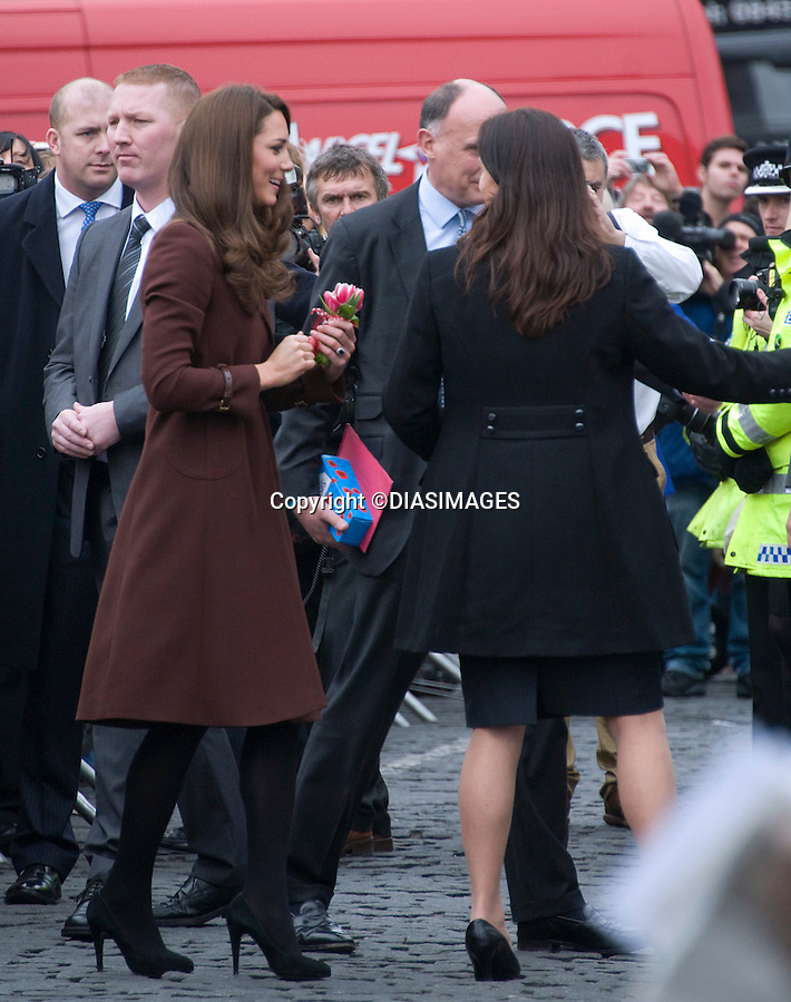 """CATHERINE, DUCHESS OF CAMBRIDGE SOLO VALENTINE'S DAY - SECURITY.Kate spent her first Valentine's Day of married life on her own, with Prince William away in the Falkland Islands London..Instead she visited a couple of her charities in Liverpool - The Brink and Alder Hey Children's Hospital..On her visit to The Brink, Kate received red roses, a Valentine card and a gift ..MANDATORY PHOTO CREDIT:©Dias/DIASIMAGES - NEWSPIX INTERNATIONAL..Mandatory credit photo:DiasImages/NEWSPIX INTERNATIONAL(Failure to credit will incur a surcharge of 100% of reproduction fees)..                **ALL FEES PAYABLE TO: """"NEWSPIX INTERNATIONAL""""**..IMMEDIATE CONFIRMATION OF USAGE REQUIRED:.DiasImages, 31a Chinnery Hill, Bishop's Stortford, ENGLAND CM23 3PS.Tel:+441279 324672  ; Fax: +441279656877.Mobile:  07775681153.e-mail: info@newspixinternational.co.uk"""