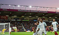 Celebrations as teammates celebrate with goalscorer Demarai Gray (Leicester City) of England U21 during the UEFA EURO U-21 First qualifying round International match between England 21 and Latvia U21 at the Goldsands Stadium, Bournemouth, England on 5 September 2017. Photo by Andy Rowland.