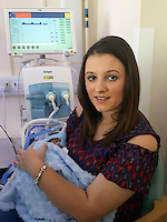 "COPY BY TOM BEDFORD<br /> Pictured: The premature baby held by Paighton Waters at the Royal Gwent Hospital in Newport, Wales, UK <br /> Re: A young couple were granted their Christmas wish to cwtch their ""miracle"" baby for the first time.<br /> Little Flynn Protheroe was the same size as a mobile phone when he was born 14 weeks early.<br /> The tiny baby and his mother Paighton Waters, 19, were both given a 50-50 chance of surviving after a rare placental abruption.<br /> Flynn was born by Caesarian and doctors worked on him for 20 minutes to get his tiny heart and lungs working.<br /> Meanwhile Paighton was on the critical list after losing four litres of blood.<br /> But five weeks later the pair are doing well and have been allowed to hold their little boy for a Christmas cuddle.<br /> Proud dad Luc Protheroe, 21, said: ""It's a miracle, I could have lost them both."