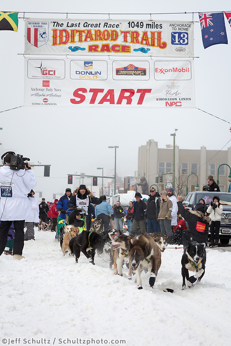 Luan Ramos Marques and team leave the ceremonial start line at 4th Avenue and D street in downtown Anchorage during the 2013 Iditarod race. Photo by Jim R. Kohl/IditarodPhotos.com