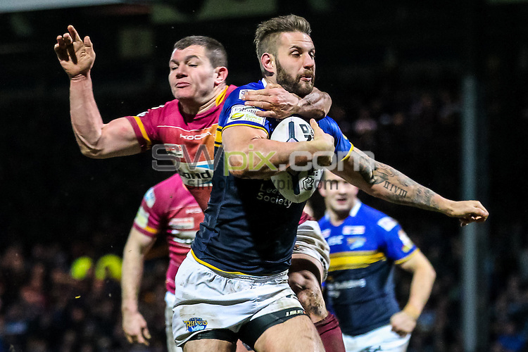 Picture by Alex Whitehead/SWpix.com - 26/02/2015 - Rugby League - First Utility Super League - Leeds Rhinos v Huddersfield Giants - Headingley Carnegie Stadium, Leeds, England - Leeds' Mitch Achurch is tackled by Huddersfield's Brett Ferres.
