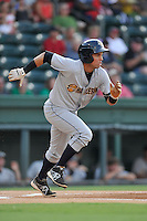 Second baseman Vicente Conde (4) of the Charleston RiverDogs bats in a game against the Greenville Drive on Friday, August 14, 2015, at Fluor Field at the West End in Greenville, South Carolina. Charleston won 6-2. (Tom Priddy/Four Seam Images)