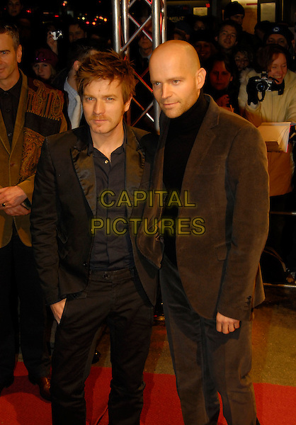"EWAN McGREGOR & MARC FORSTER.Premiere of ""Stay"" at the 56th Berlin (Berlinale) Film Festival, Berlin, Germany..February 13th, 2006.Ref: KRA.half length black suit.www.capitalpictures.com.sales@capitalpictures.com.©Capital Pictures"