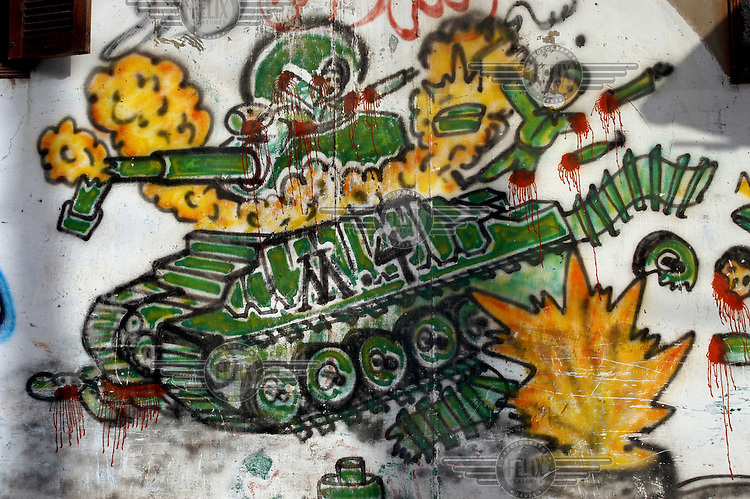 A grafitti picture on a wall in Gaza depicting an Israeli tank being blown up.
