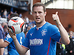 Jon Daly awalks off with the match ball