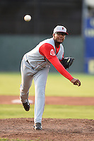 Lowell Spinners pitcher Mario Alcantara (99) delivers a pitch during a game against the Batavia Muckdogs on July 18, 2014 at Dwyer Stadium in Batavia, New York.  Lowell defeated Batavia 11-2.  (Mike Janes/Four Seam Images)