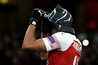 Pierre-Emerick Aubameyang of Arsenal takes off his mask  after celebrating scoring their third goal during during Arsenal vs Rennes, UEFA Europa League Football at the Emirates Stadium on 14th March 2019