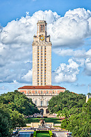 UT Tower Vertical- This is the UT Tower taken from the south side with the Littlefield Fountain in view with nice puffy clouds and blue sky.  The University of Texas towers is 307 feet tall and can be seen from many locations through out the city. It has become a part of the Austin cityscape.   The UT Tower is a landmark for all as it can be seen from many locations throughout the city.  Toursits and local have been comming to see this historical tower in downtown part of the city.