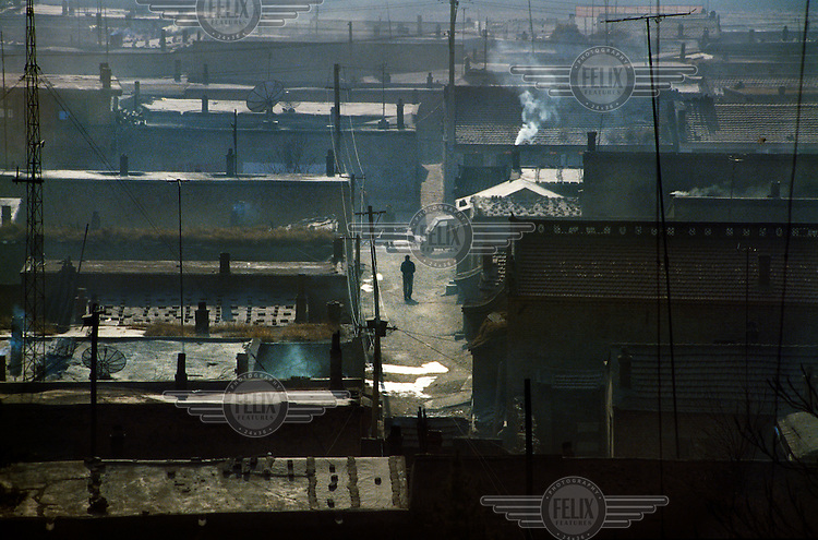 Housing for miners on the outskirts of the city which is considered to be one of the most polluted in the world..