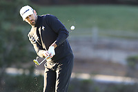 NFL Green Bay Packers quarterback Aaron Rodgers chips onto the 1st green at Spyglass Hill during Thursday's Round 1 of the 2018 AT&amp;T Pebble Beach Pro-Am, held over 3 courses Pebble Beach, Spyglass Hill and Monterey, California, USA. 8th February 2018.<br /> Picture: Eoin Clarke | Golffile<br /> <br /> <br /> All photos usage must carry mandatory copyright credit (&copy; Golffile | Eoin Clarke)