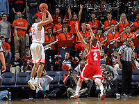 Dec. 07, 2010; Charlottesville, VA, USA;  Virginia Cavaliers guard Joe Harris (12) shoots over Radford Highlanders guard Evan Faulkner (2) at the John Paul Jones Arena. Mandatory Credit: Andrew Shurtleff