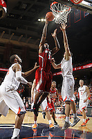 North Carolina State forward Richard Howell (1) shoots over Virginia defenders during the game Saturday in Charlottesville, VA. Virginia defeated NC State 58-55.