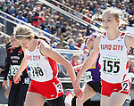 RAPID CITY, SD - MAY 30: Alaina Klapperich #148 of Rapid City Central leans ahead of her teammate Hannah Young #155 in the girls class AA 100 meter dash during the 2015 SDHSAA State Track & Field Meet Saturday at O'Harra Stadium in Rapid City, S.D. (Photo by Dick Carlson/Inertia)