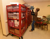 NWA Democrat-Gazette/FLIP PUTTHOFF<br />Sharon Rose, staff assistant, packs items Tuesday Jan. 2 2018 during the Benton County Election Commission's move from Bentonville to Rogers. The new location is in the former Kmart building, 2113 W. Walnut, in Rogers.