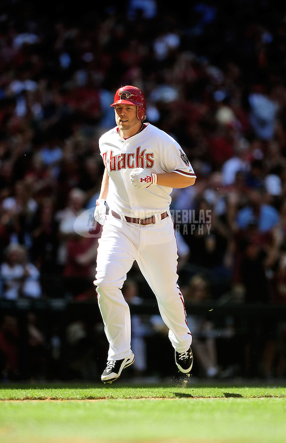 Apr. 5, 2010; Phoenix, AZ, USA; Arizona Diamondbacks third baseman Mark Reynolds rounds the bases after hitting a home run against the San Diego Padres during opening day at Chase Field. Mandatory Credit: Mark J. Rebilas-