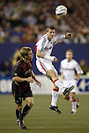 2 October 2004: Joshua Gros (center) jumps over Chris Leitch (3) to head the ball early in the game. DC United defeated the MetroStars 1-0 at Giants Stadium in East Rutherford, NJ during a regular season Major League Soccer game..