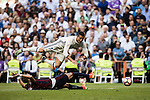 Cristiano Ronaldo of Real Madrid falls as he fights for the ball with Lejeune of SD Eibar during their La Liga match between Real Madrid CF and SD Eibar at the Santiago Bernabéu Stadium on 02 October 2016 in Madrid, Spain. Photo by Diego Gonzalez Souto / Power Sport Images
