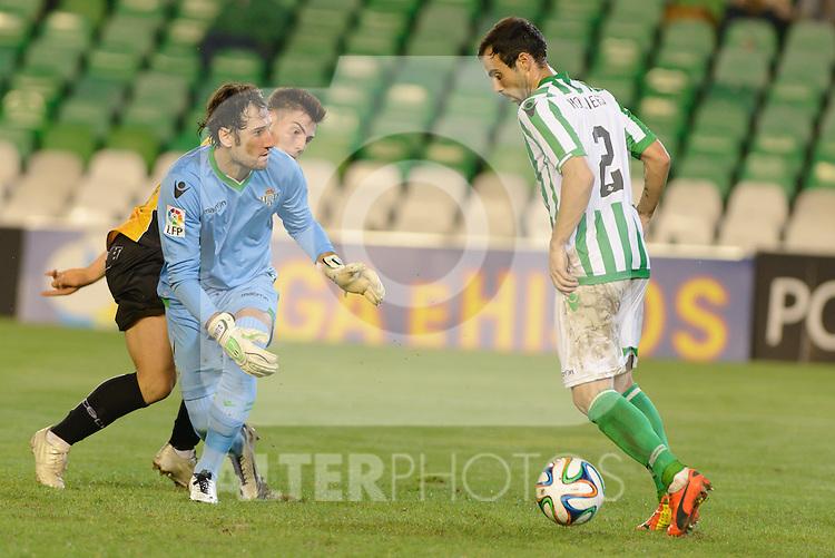 Sevilla, España, 15 de octubre de 2014: Dani (I) pide a Molinero (D) el balon durante el partido entre Real Betis y Lugo correspondiente a la jornada 5 de la Copa del Rey 2014-2015 celebrado en el estadio Benito Villamarain de Sevilla.