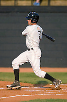 Daniel Wagner #7 of the Bristol Sox follows through on his swing versus the Princeton Rays at DeVault Memorial Stadium June 26, 2009 in Bristol, Virginia. (Photo by Brian Westerholt / Four Seam Images)
