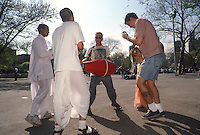 New York, NY - Man dancing with Hare Krishna in Washington Square Park