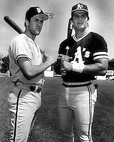 Giants Will Clark and A's Jose Canseco. (photo by Ron Riesterer)