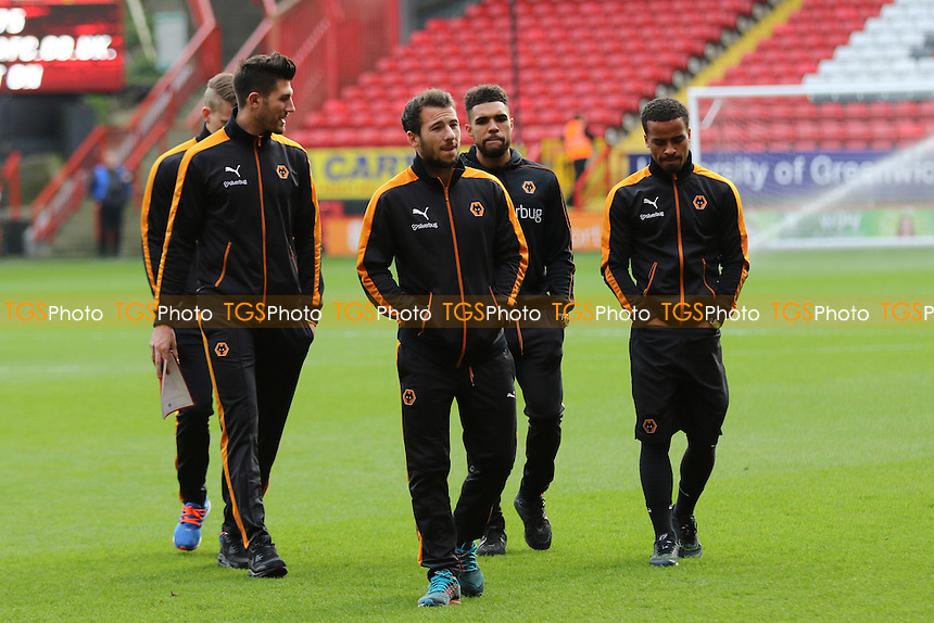 Adam La Fondre walks across the Charlton pitch pre-match with his Wolves teammates during Charlton Athletic vs Wolverhampton Wanderers, Sky Bet Championship Football at The Valley, London, England on 28/12/2015