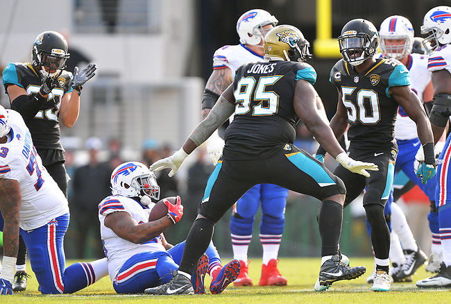 Jacksonville Jaguars defensive tackle Abry Jones (95) celebrates after dropping Buffalo Bills running back Mike Tolbert (35) for a 1 yard loss with 10:32 to play in the third quarter in a NFL Wildcard Playoff game Sunday, January 7, 2018 in Jacksonville, Fl.  (Rick Wilson/Jacksonville Jaguars)