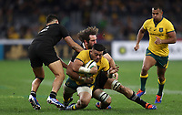 Tolu Latu of the Wallabies is tackled by Samuel Whitelock of the All Blacks during the Rugby Championship match between Australia and New Zealand at Optus Stadium in Perth, Australia on August 10, 2019 . Photo: Gary Day / Frozen In Motion