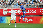 10 August 2008: Breno (BRA) (14) leaps for a header in front of Chris Killen (NZL) (10).  The men's Olympic soccer team of Brazil defeated the men's Olympic soccer team of New Zealand 5-0 at Shenyang Olympic Sports Center Wulihe Stadium in Shenyang, China in a Group C round-robin match in the Men's Olympic Football competition.