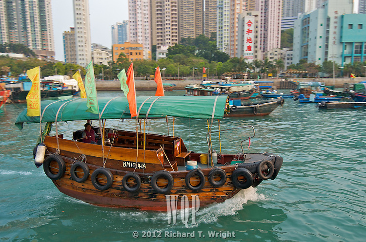 Hong Kong harbour  A sampan ferry crosses Aberdeen Harbour, Hong Kong