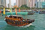 Hong Kong harbour  A sampan ferry crosses Aberdeen Harbour, Hong Kong