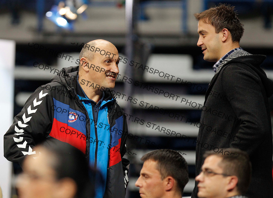 BELGRADE, SERBIA - DECEMBER 16:  Head coach Sasa Boskovic (L) of Serbia and Momir Ilic (R) during the 2013 World Women's Handball Championship 2013 match between South Korea v Serbia at Kombank Arena Hall on December 16, 2013 in Belgrade, Serbia. (Photo by Srdjan Stevanovic/Getty Images)