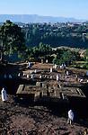 ETHIOPIA Lalibela, Maria mass at St. Georgys rock church, the monolith rock churches were built by King Lalibela 800 years ago / AETHIOPIEN Lalibela oder Roha, Marien Gottesdienst an der St. Georg Kirche , Koenig LALIBELA liess die monolithischen Felsenkirchen vor ueber 800 Jahren in die Basaltlava auf 2600 Meter Hoehe hauen und baute ein zweites Jerusalem nach