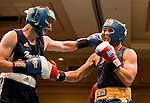 February 3, 2012:   Nevada boxer Alex Flangas, left, fights against Cal boxer Robert Watts in the 175 pound weight class match held at the Eldorado Convention Center on Friday night in Reno, Nevada.  Flangas won by decision.