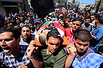 Mourners carry the body of Palestinian Raed Abu Tair, who was killed during a protest at the Israel-Gaza border fence, during his funeral in Khan Yunis in the southern Gaza Strip on May 4, 2019. Reports state five Palestinians were killed, including three in Israeli airstrikes in the Gaza Strip and two during protests after Friday prayer near the border with Israel eastern Gaza Strip. Photo by Ramadan EL-Agha