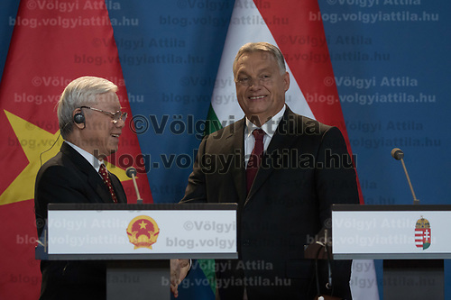 Nguyen Phu Trong (L) General Secretary of the Communist Party of Vietnam and Viktor Orban (R) prime minister of Hungary shake hands after a joint press conference in Budapest, Hungary on Sept. 10, 2018. ATTILA VOLGYI