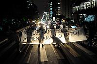 SAO PAULO, SP, 31.10.2013 -PROTESTO IPTU. Grupo protesta contra o aumento do IPTU na Av Paulista ate a casa do Prefeito de São Paulo  . -  Adriano Lima / Brazil Photo Press)