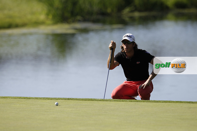 Romain Wattel (FRA) lines up his putt on the 4th green during Thursday's Round 1 of the 2014 Open de Espana held at the PGA Catalunya Resort, Girona, Spain. Wednesday 15th May 2014.<br /> Picture: Eoin Clarke www.golffile.ie
