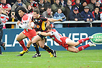 Rhodri Gomer Davies gets tackled by Olly Barkley. Gloucester V Newport Gwent Dragons, EDF Energy Cup © Ian Cook IJC Photography iancook@ijcphotography.co.uk www.ijcphotography.co.uk