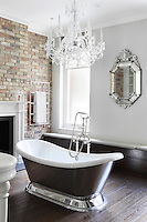 An elegant bathroom just for Annabel, furnished with a period style roll top bath and antique style fittings