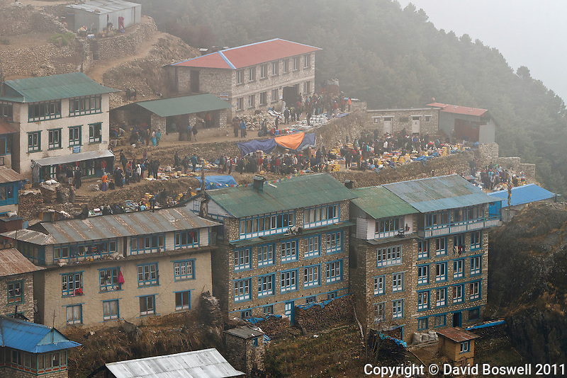 The Friday Market is busy despite the foggy weather in Namche Bazaar, Nepal.