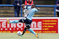 Jon-Paul Pittman of Grimsby Town attempts a block during the Vanarama National League match between Dover Athletic and Grimsby Town at the Crabble Athletic Ground, Dover, England on 16 April 2016. Photo by Tony Fowles/PRiME Media Images.