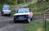 Nick Elliot / Dave Price at Junction 6, on Special Stage 1 Craigvinean in the Colin McRae Forest Stages Rally 2012, Round 8 of the RAC MSA Scotish Rally Championship which was organised by Coltness Car Club and based in Aberfeldy on 5.10.12.