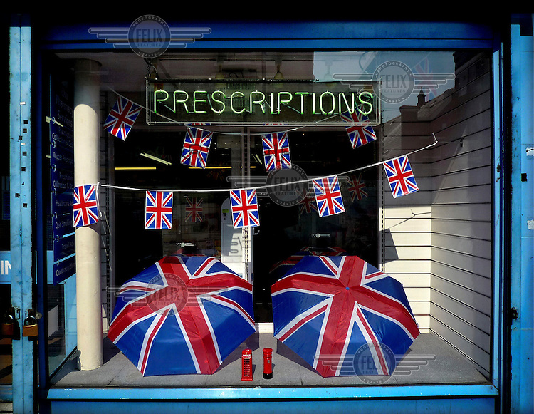 A pharmacy decorated with Union Jack flags on Portobello Road in London, celebrated the Diamond Jubilee of Queen Elizabeth II.